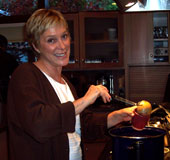 lisa ladles the soup into wine cups @thanksgiving